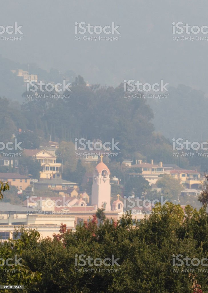 Smoke from wildfire over town stock photo