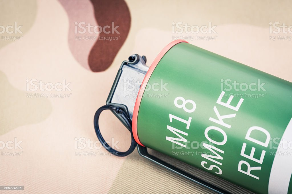 Smoke grenade red color M18,frag explosion stock photo