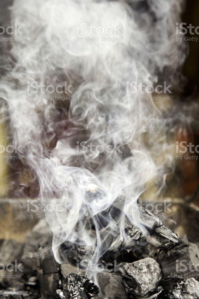 Smoke on the embers stock photo