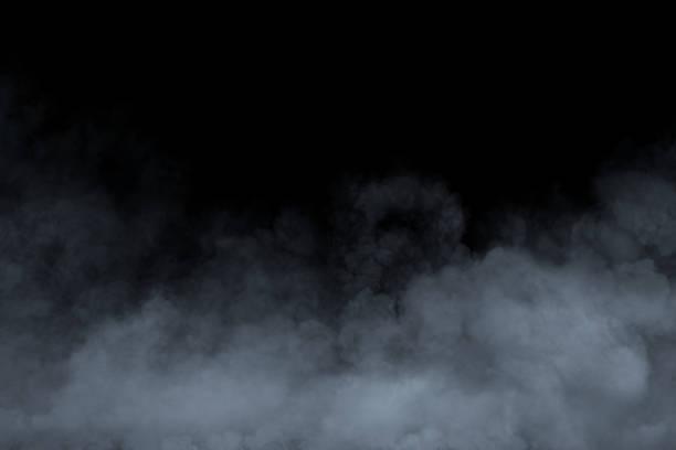 Smoke or fog isolated on black background stock photo