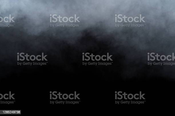 Photo of Smoke or fog isolated on black background