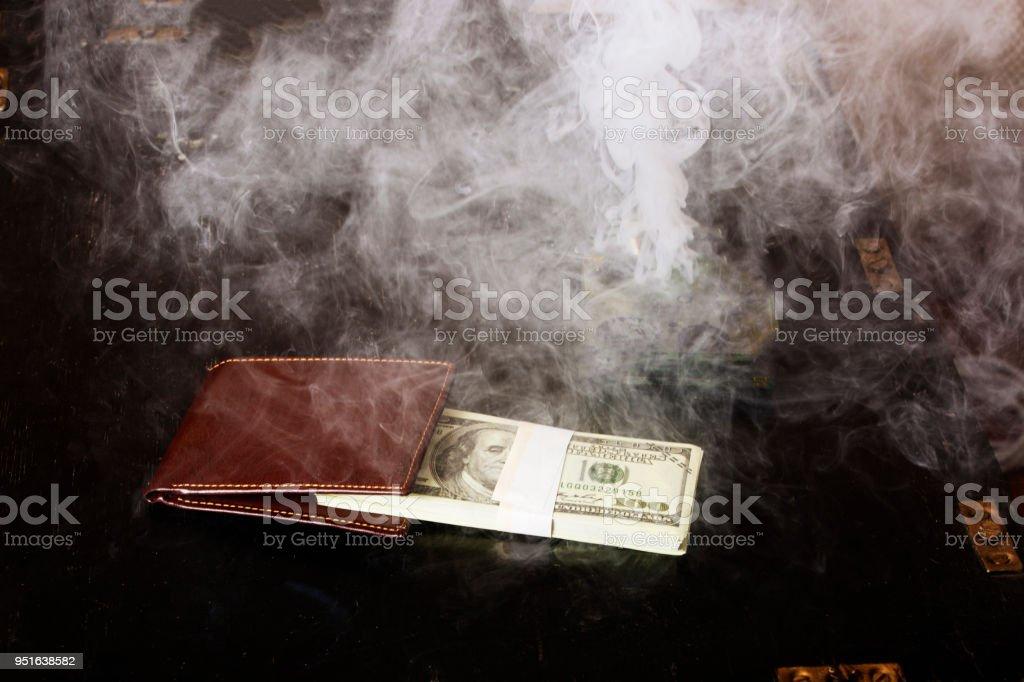 Smoke over money in wallet