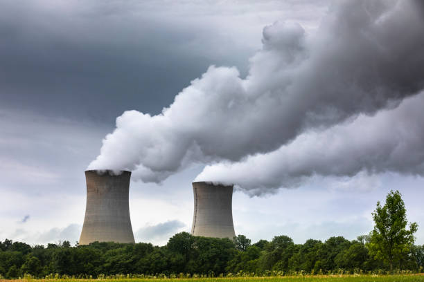 Smoke pollution flows from an industrial smoke stack chimney stock photo