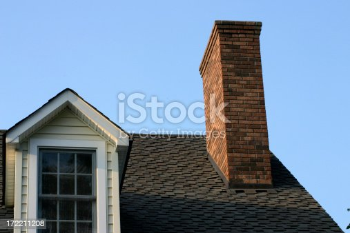 Partial roof with nice solid blue sky for text.