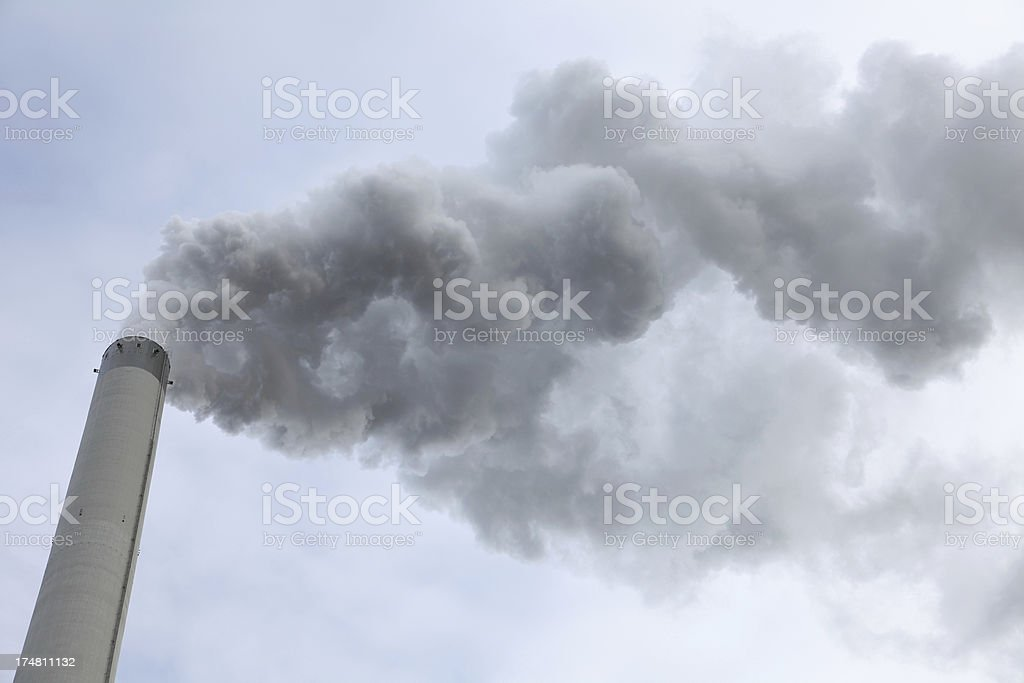 Smoke released by a chimney royalty-free stock photo
