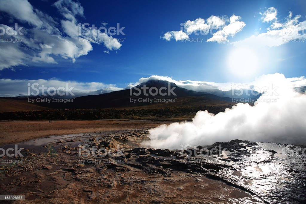 Smoke rising from the Geyser del Tatio stock photo