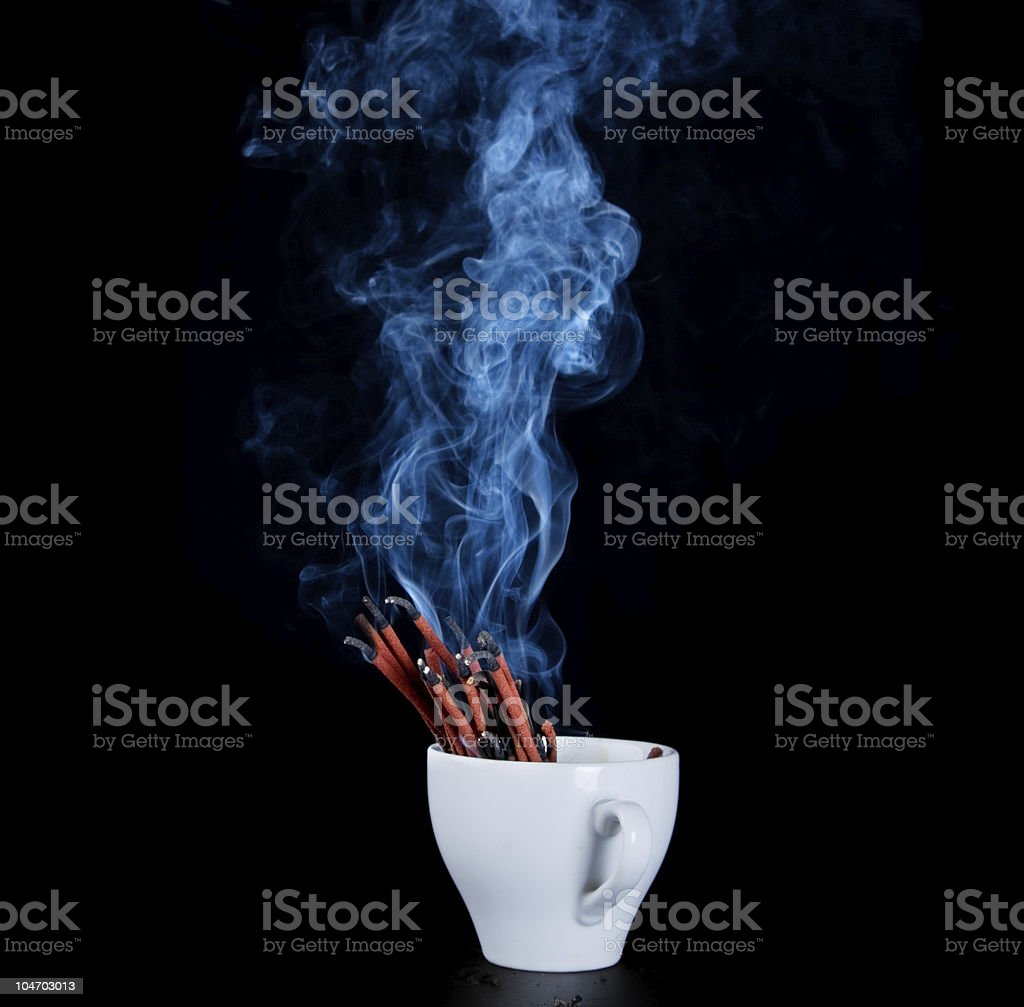 Smoke spices from cups stock photo