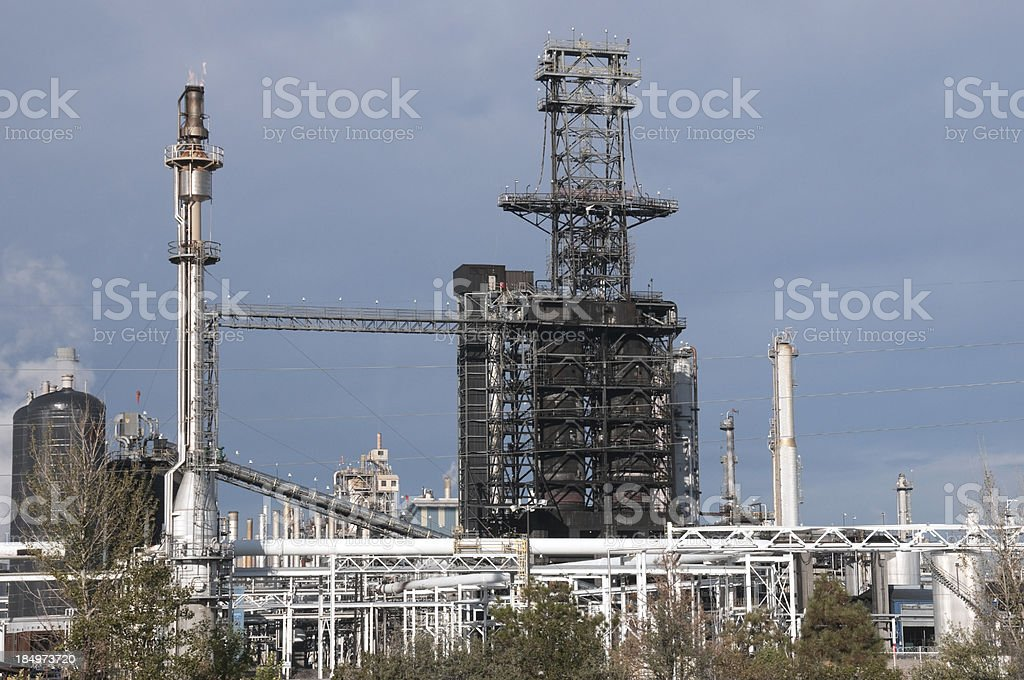 Smoke stack at oil refinery royalty-free stock photo