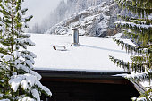 Smoke Stack at Snow Roof