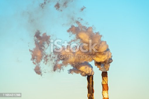 Clouds of smoke emitted into the sunset environment from crushing season at an Australian sugar cane mill refinery