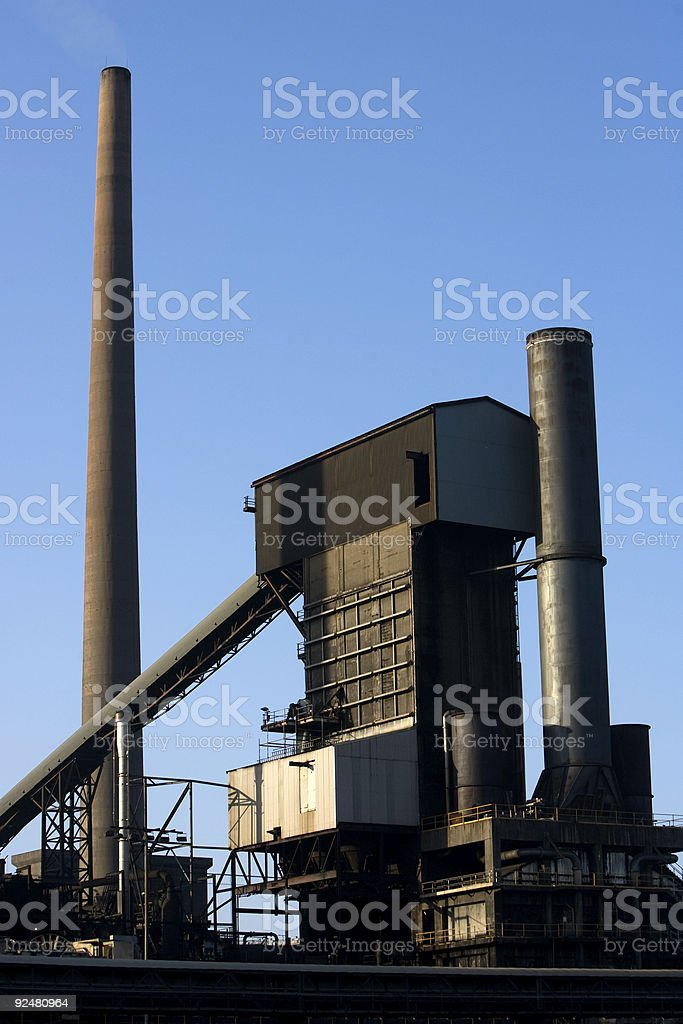 Smoke stacks and conveyer building royalty-free stock photo
