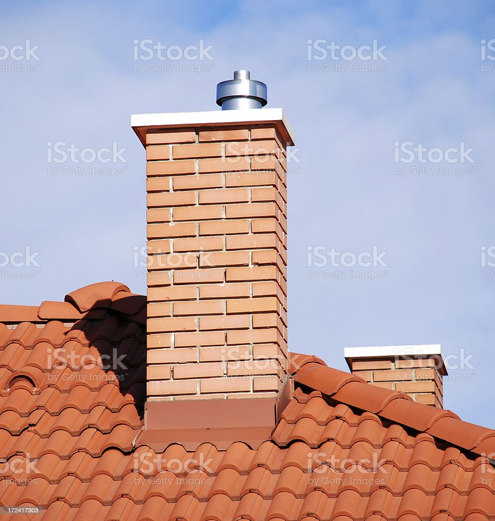 smoke stacks on the tiled roof stock photo