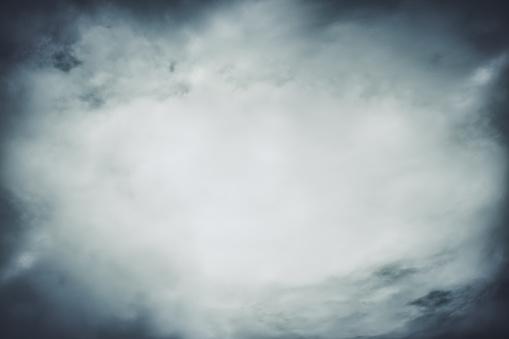 Smoke texture over blank black background. Halloween design with copyspace