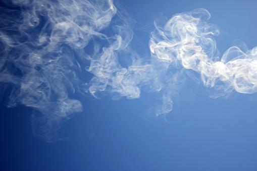 smoke towards the blue sky