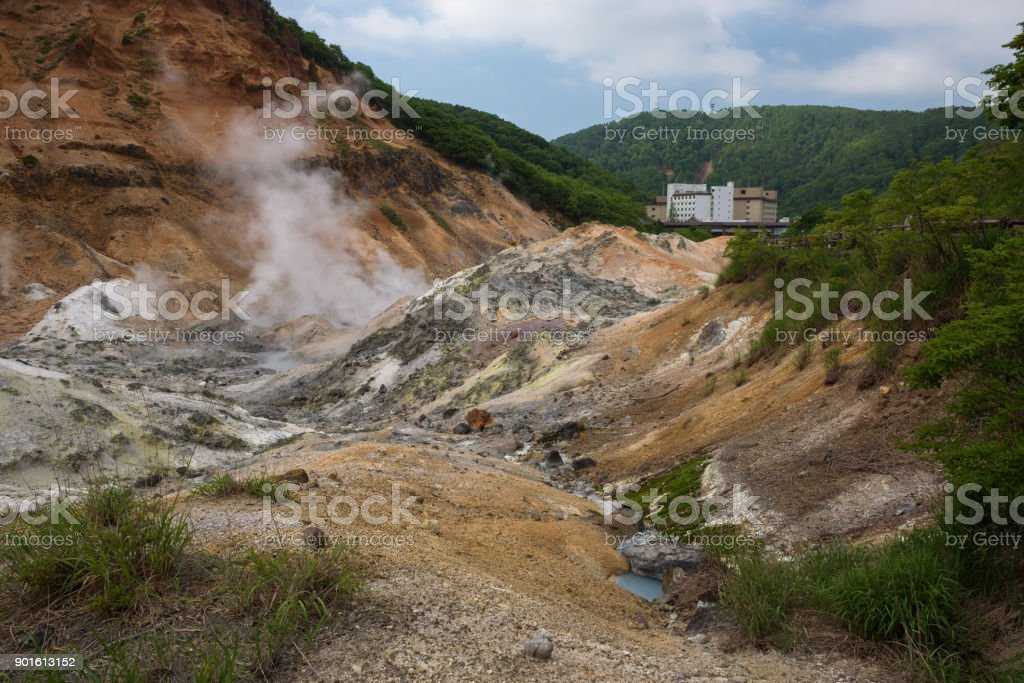 Smoke vents escaping from earth's surface in Hell Valley (Jigokudani) stock photo