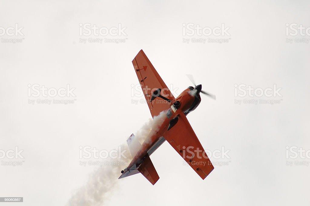 Smoke White Airplane in motion stock photo