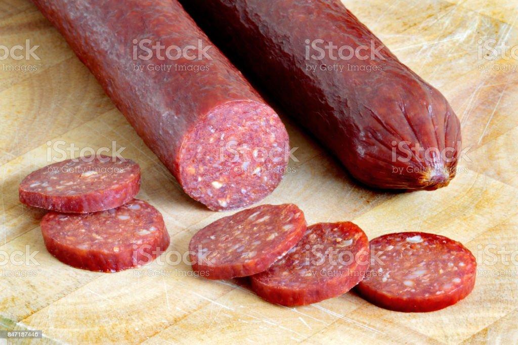 Smoked and dried  sausage stock photo