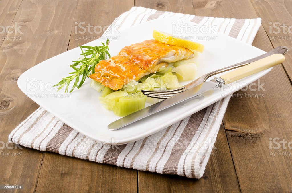 smoked and steamed haddock fillet with celery stock photo