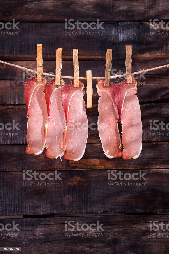 Smoked bacon hanging stock photo