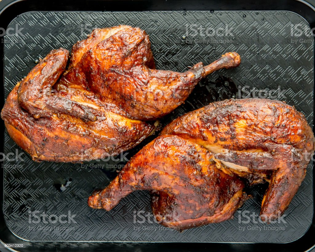 Smoked Barbecue Half Chicken stock photo