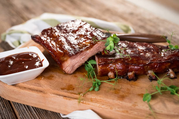 Smoked Barbecue Pork Spare Ribs Smoked Barbecue Pork Spare Ribs pork stock pictures, royalty-free photos & images