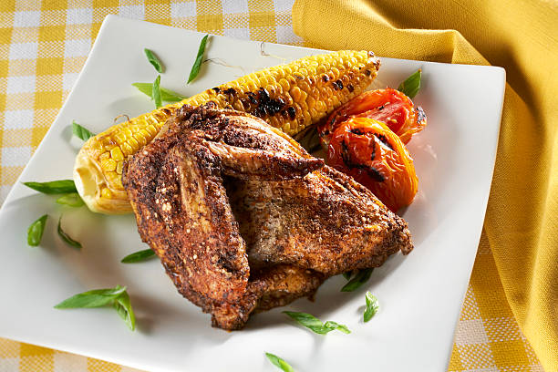 Smoked Barbeque Chicken Breast with Corn on the Cob stock photo