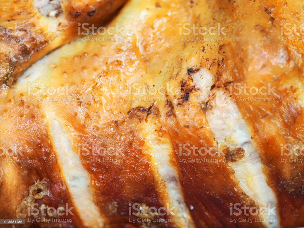 Smoked chicken background. Festive dish. Appetizing meat product of golden color, white meat, barbecue stock photo