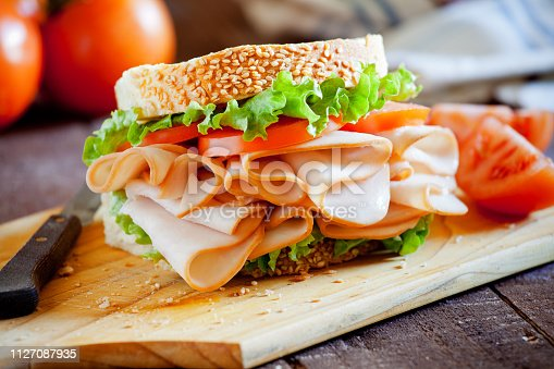 Homemade sandwich with smoked chicken and lettuce