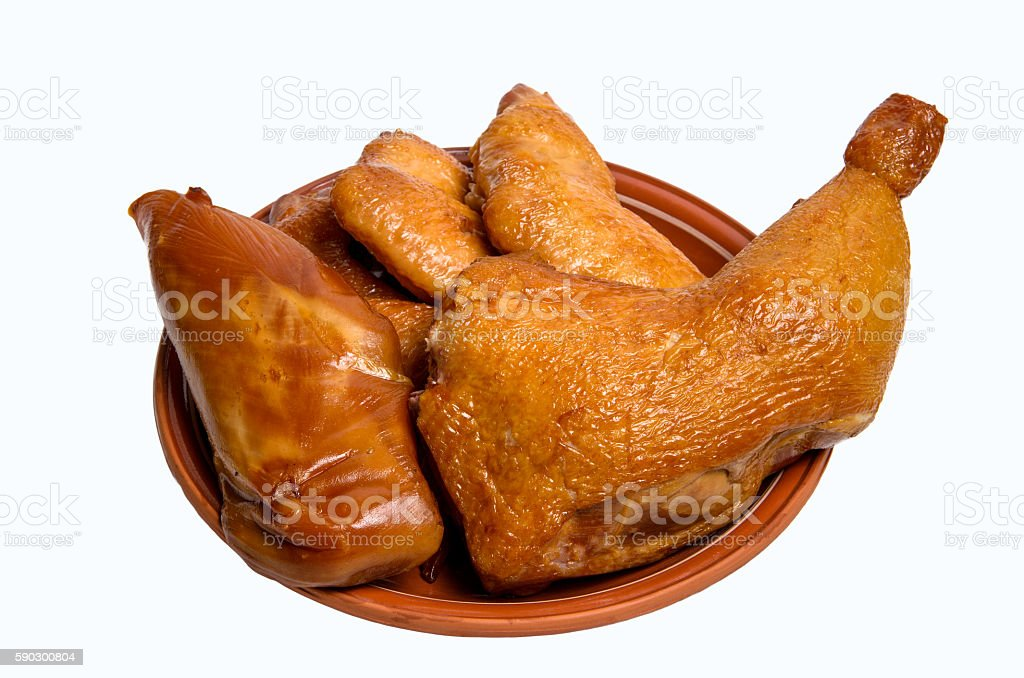Smoked chicken set on plate isolated white background Стоковые фото Стоковая фотография