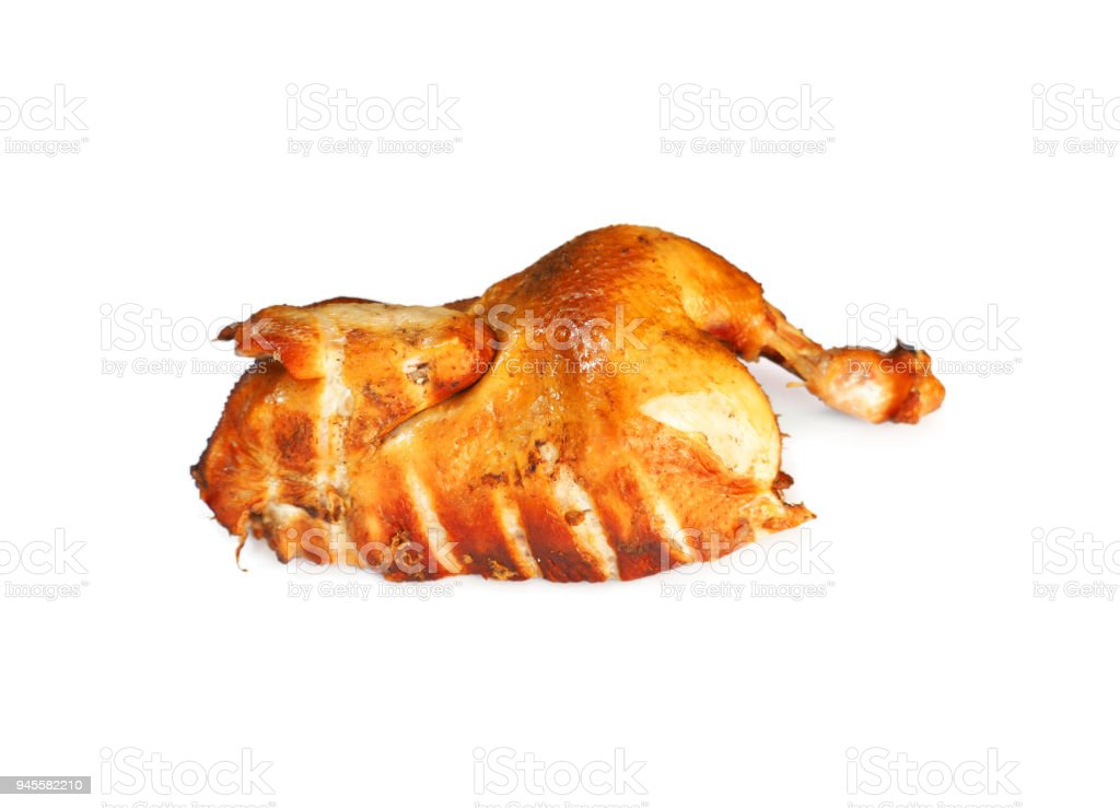 Smoked chicken with a ruddy crust isolated on a white background. Festive dish. Half roasted chicken. Appetizing meat product of golden color, white meat, barbecue stock photo