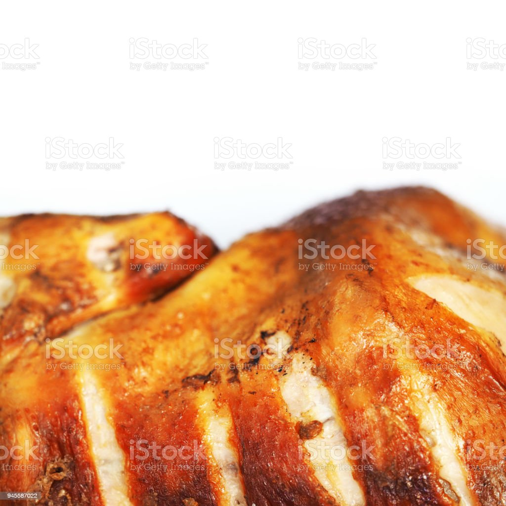 Smoked chicken with a ruddy crust isolated on a white background. Festive dish. Half fried chicken. Appetizing meat product of golden color, white meat, barbecue, close-up, space for text stock photo