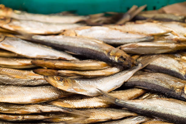 smoked fish for sale at fish market. smoked at smokehouse, delicious appetiser - appetiser stock photos and pictures