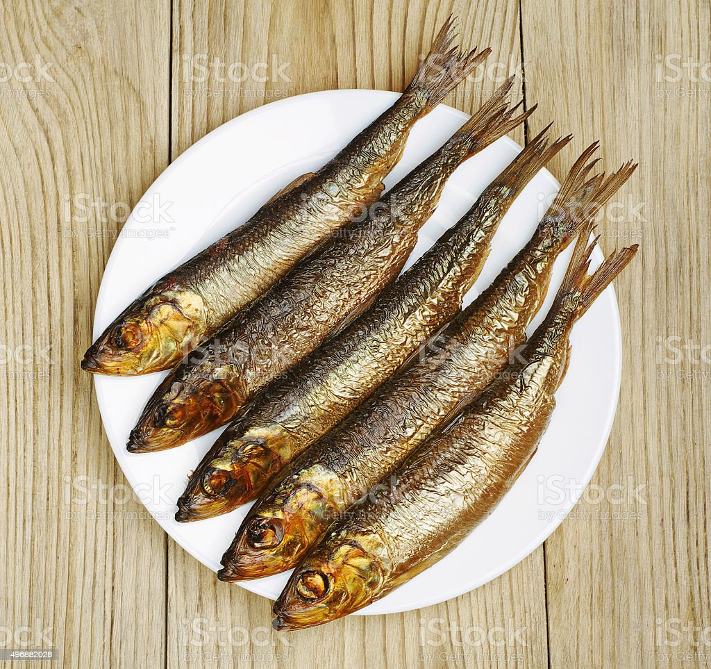 Smoked fish in a plate stock photo