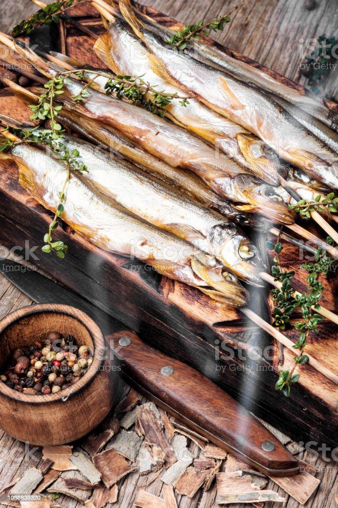 Smoked fish in a smoker stock photo
