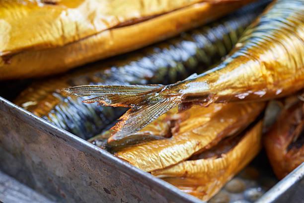 Smoked fish in a tin pan. Smoked mackerel stock photo