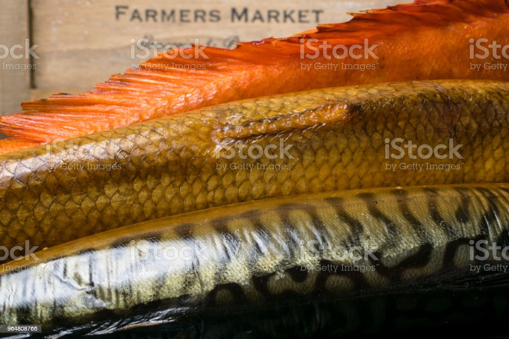 Smoked fish on the wooden table in farmer market royalty-free stock photo
