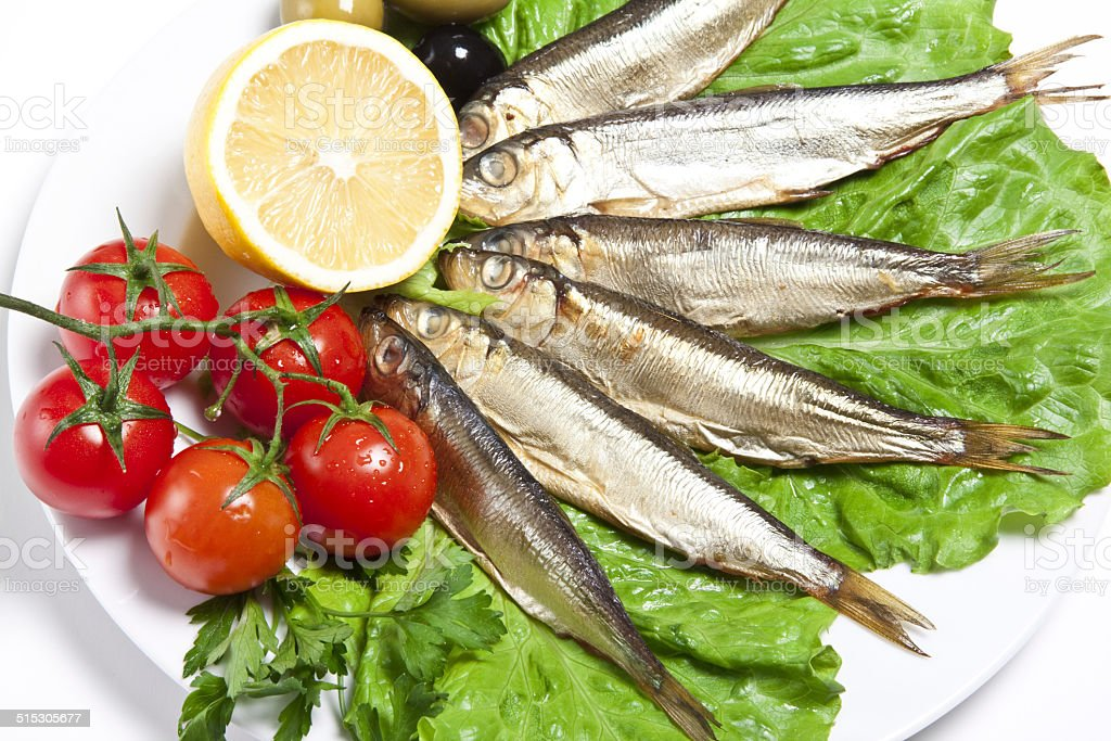 smoked fish served with tomato stock photo