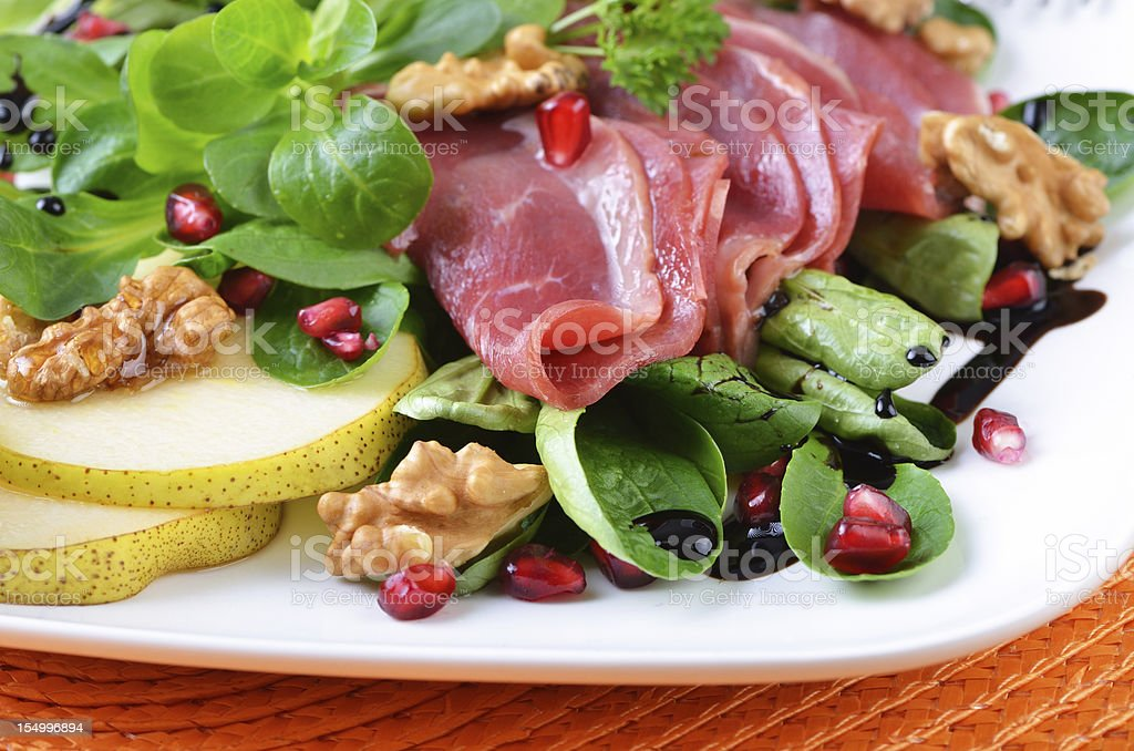 Smoked goose breast on salad royalty-free stock photo