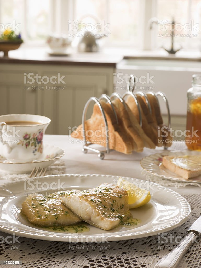 Smoked Haddock with Herb Butter and Toast royalty-free stock photo