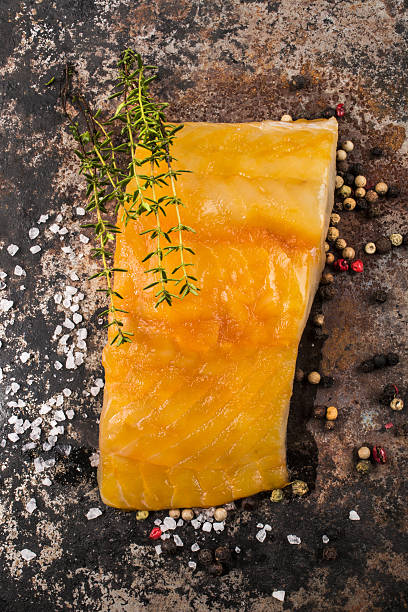 smoked haddock with thyme, peppercorn and salt stock photo