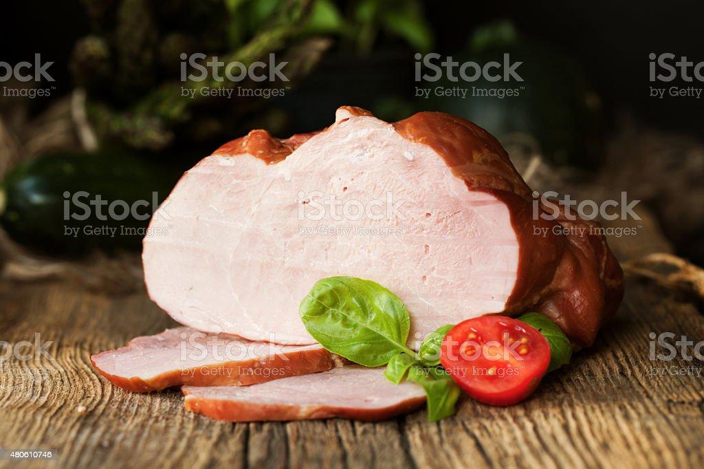 Smoked ham on a chopping board. stock photo
