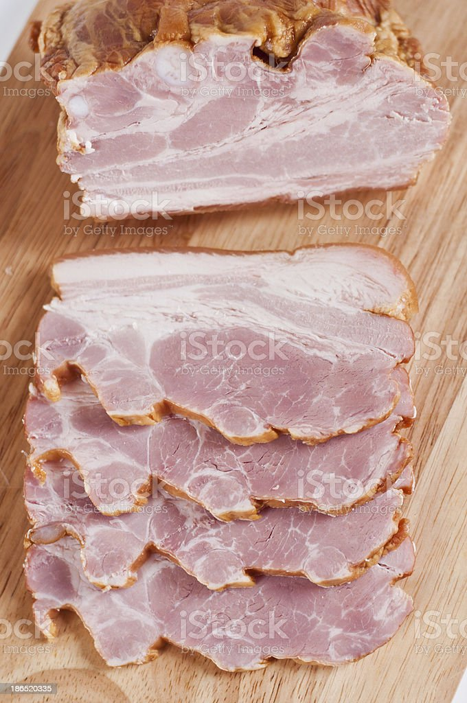 Smoked ham on a cutting board royalty-free stock photo