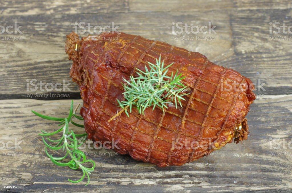 smoked ham with juniper stock photo
