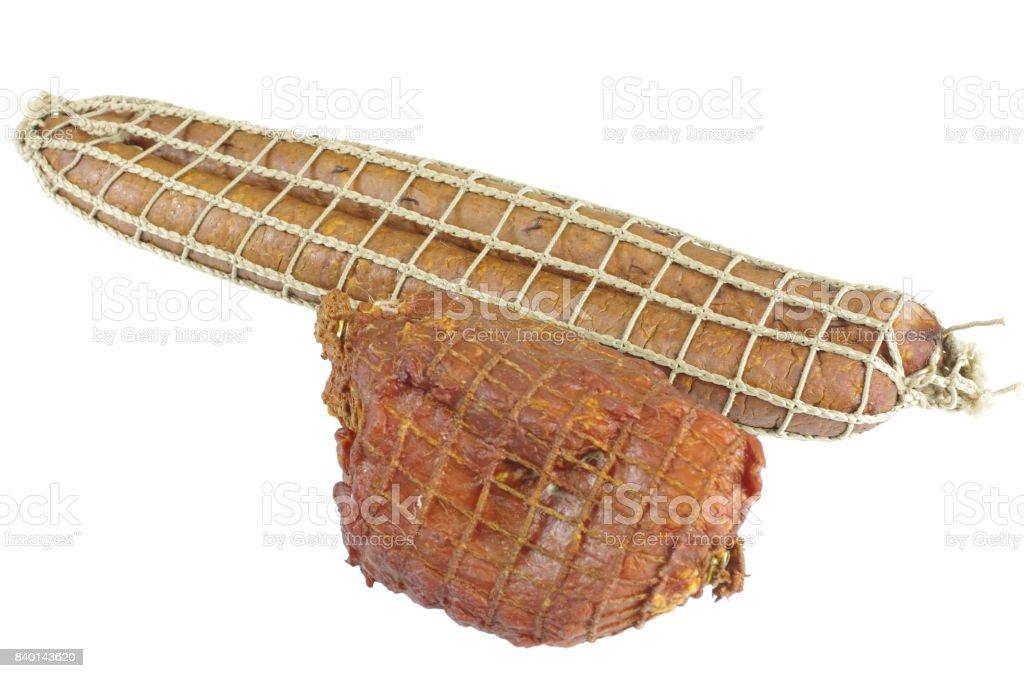 smoked ham with sausage isolated stock photo