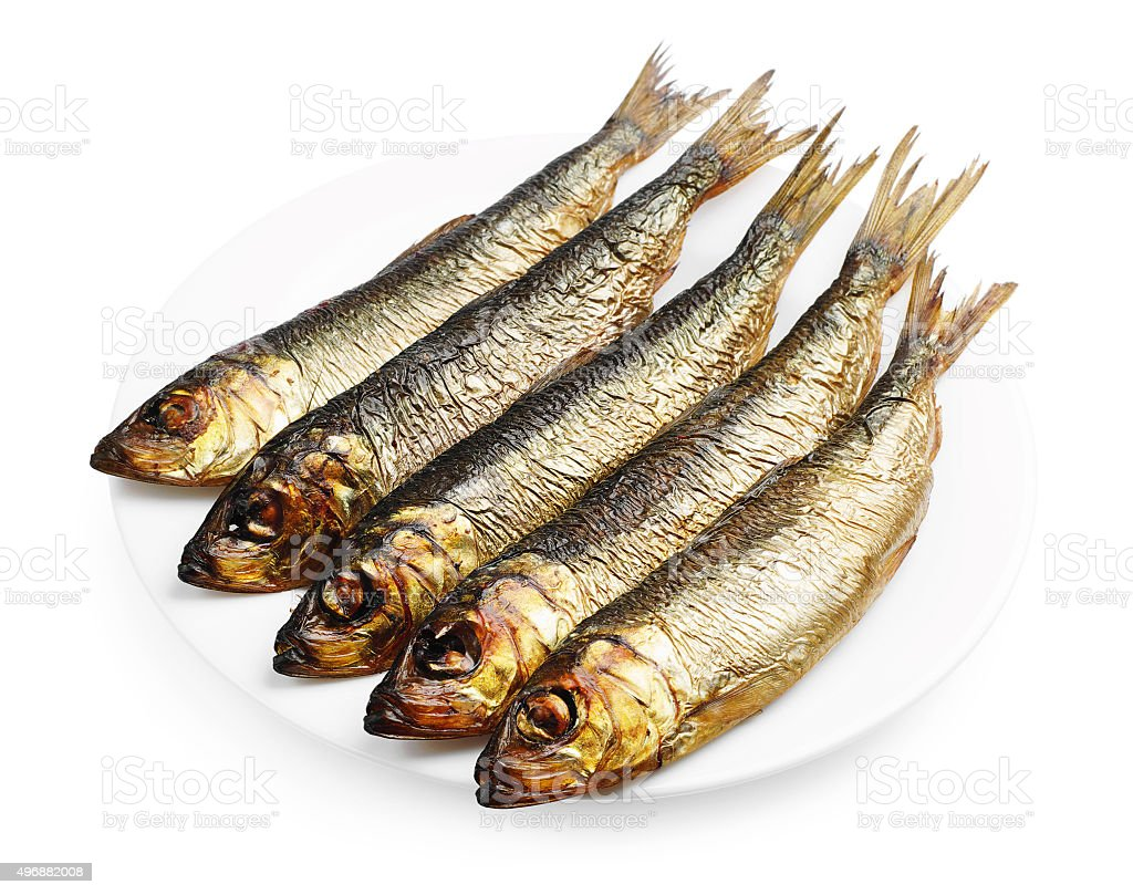 Smoked herring in a plate stock photo
