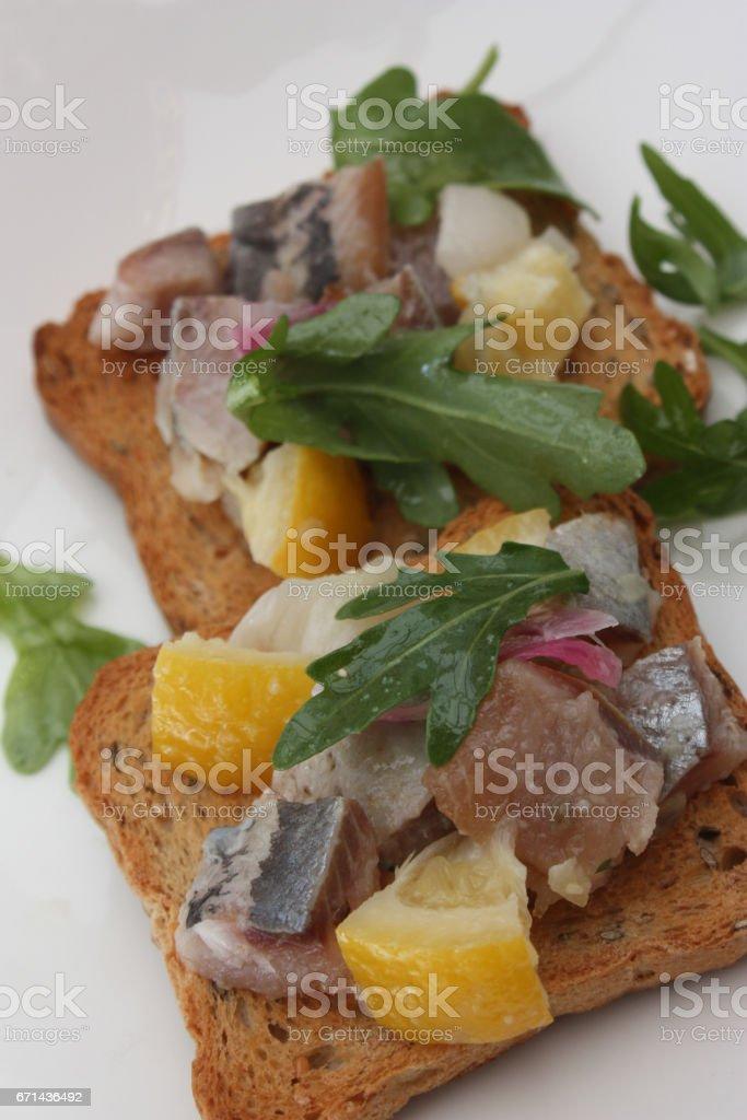 Tartine de hareng fumé au citron confit - Apéritif mise en bouche stock photo