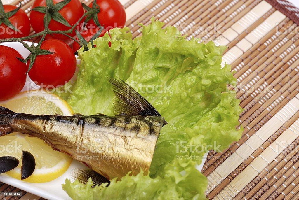Smoked mackerel on a plate royalty-free stock photo