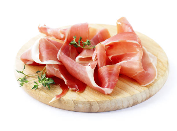 Smoked Parma ham on a wooden board stock photo