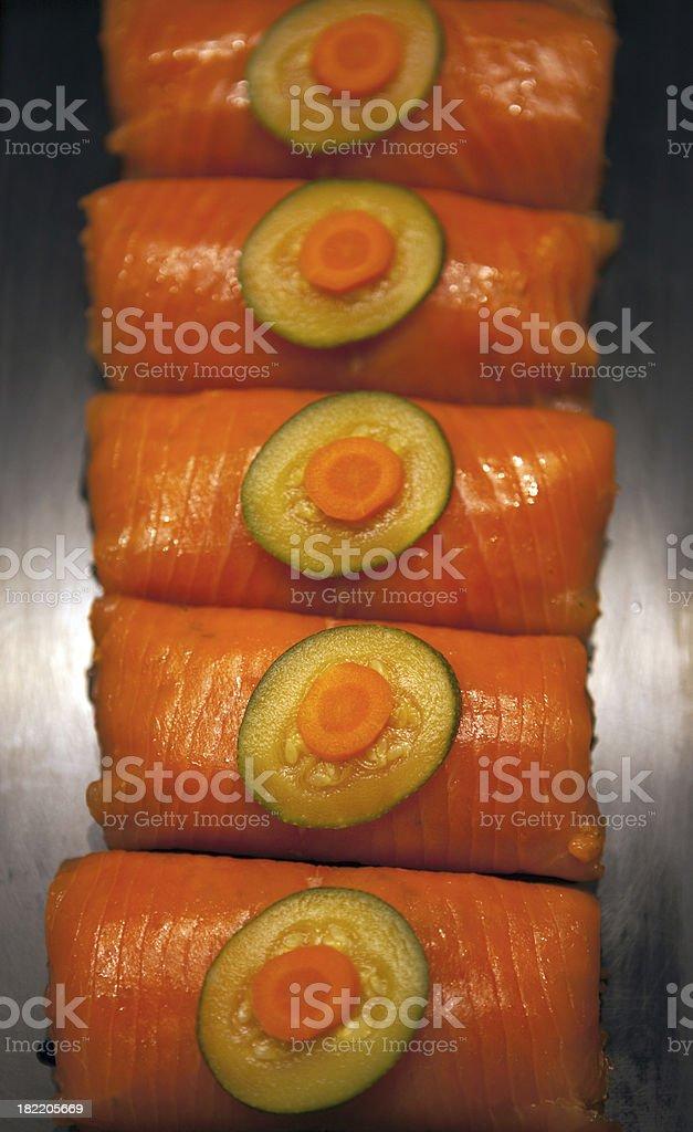 Smoked pink salmon roulades royalty-free stock photo