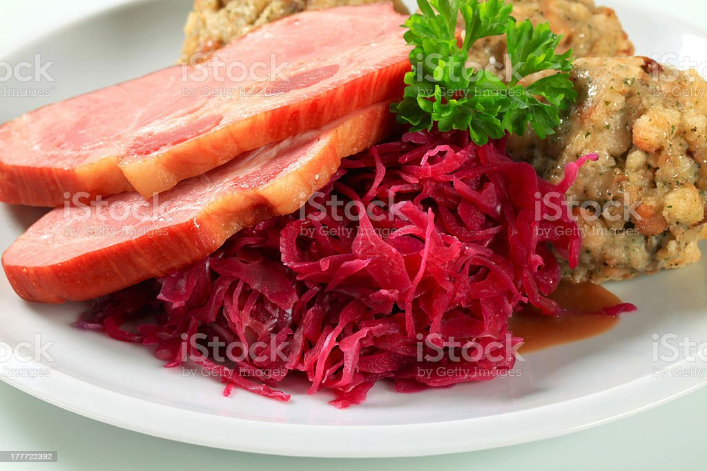 Smoked pork with Tyrolean dumplings and red kraut royalty-free stock photo